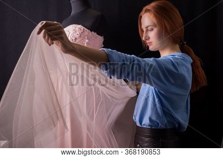 Wedding Delicate Pink Dress On A Mannequin, In The Manufacturing Process. In A Design Studio. A Prof