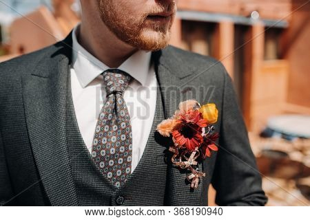 Groom In A Jacket And Boutonniere Close-up.groom Close-up In Provence, France, The Grooms Fees.