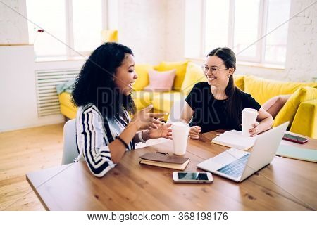 Active Black Woman Talking To Smiling Friend Explaining Information