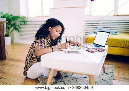 Diligent Black Student Doing Homework, Working On Freelance
