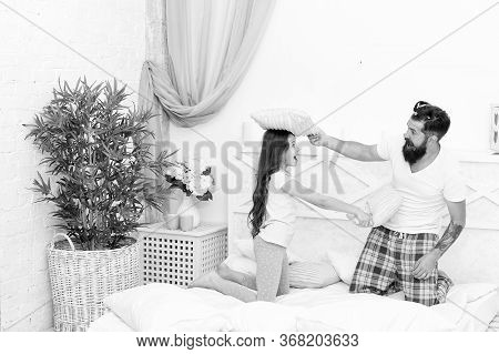 Friendly Relations. Little Daughter And Father Play Pillow Fight. Bearded Man And Small Child Enjoy