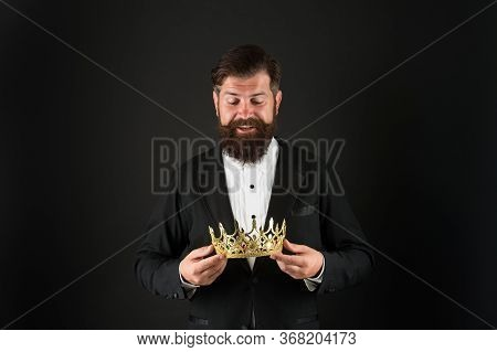 Reputation And Status. Now Come And Make It Worth. Crown In Hands. Handsome Man Give Crown Black Bac