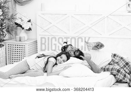 Good Night To The Morning. Happy Family Go To Sleep At Night. Bearded Man Put Daughter To Sleep. Bed