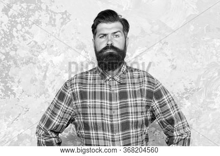 Guy Hipster Outfit. Mature And Trendy. Masculine Traits. Brutal Bearded Man Concrete Background. Ser