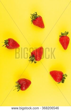 A Top View Red Strawberries Mellow Juicy Isolated On The Yellow Background