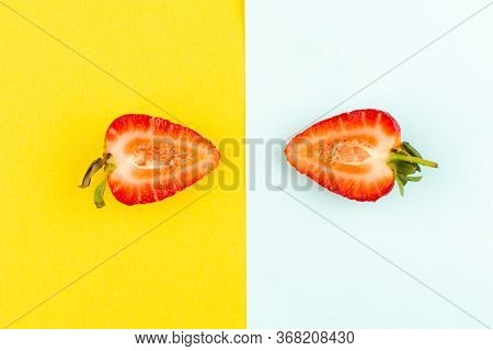 A Top View Half Cut Strawberries Mellow Juicy On The Yellow-blue Background