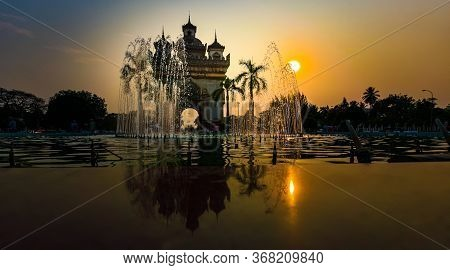 Patuxai War Memorial Water Fountain Against The Sunset
