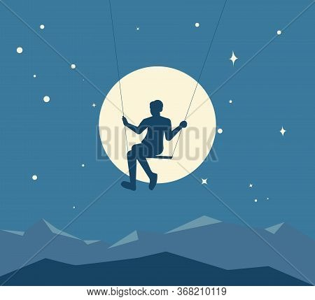 Silhouette Of A Boy Swinging On A Swing Against The Background Of The Moon And The Starry Night Sky.