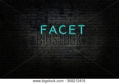 Night View Of Neon Sign On Brick Wall With Inscription Facet