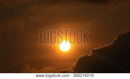Beautiful Orange Golden Sky With Rich In Dark Clouds, And Sunshine, Sunrise Wallpaper Background In