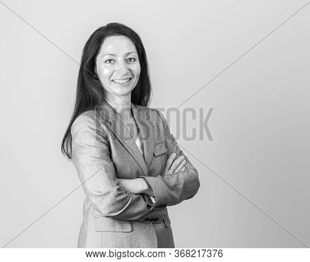 Black And White Portrait Of A Beautiful Woman Or Business Woman Lady In Gray Suit.