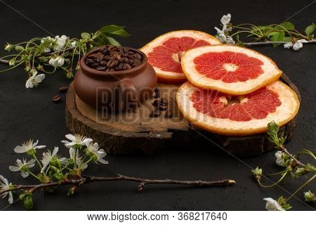 A Top View Sliced Grapefruits Fresh Ripe Juicy Mellow Along With Coffee Brown Seeds On The Dark Floo