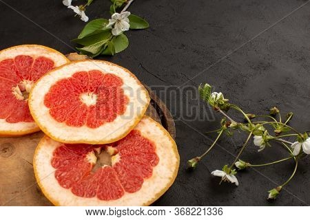 A Top View Sliced Grapefruit Mellow Juicy Rings On The Dark Background