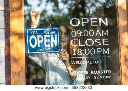 Closeup Asian Young Asian Woman Setting Open Sign At The Shop Glasses For Welcome The Customer In To