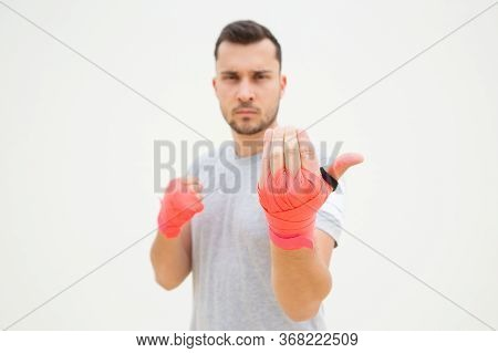 Unfocused Man Provoking For Fight. Guy With Wrapped Hands Wishing For Boxing With You. Invitation Ge
