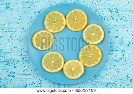 A Top View Sliced Lemon Sour Juicy Mellow Inside Blue Plate On The Bright Blue Floor