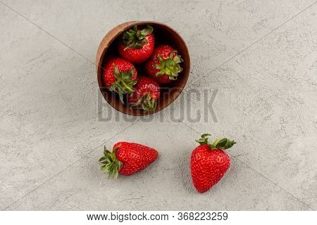 A Top View Strawberries Red Fresh Mellow Juicy Inside Brown Pot On The Grey Floor