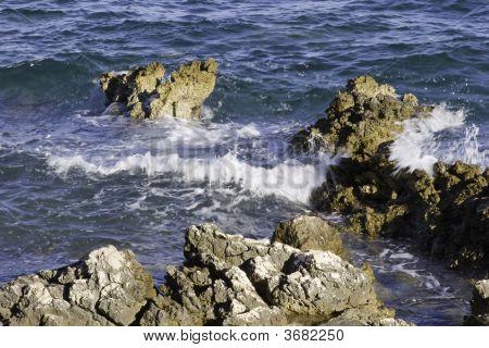 Beach Wave On Cliffs