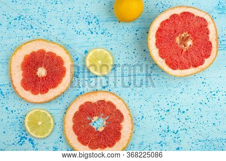 A Top View Citrus Slices Grapefruit And Lemon Sliced Mellow Sour Ripe On The Bright Blue Floor