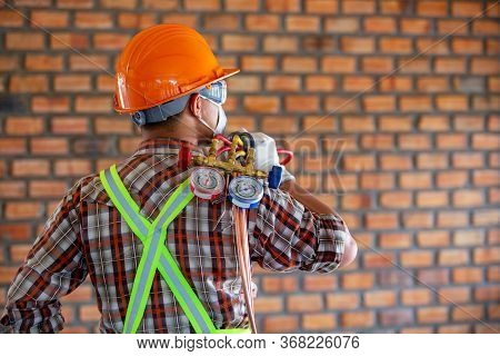 Air Conditioner Technician Ready To Work With A Gauge Miter