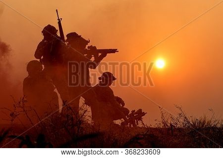 The Silhouette Of A Military Soldier With The Sun As A Marine Corps For Military Operations