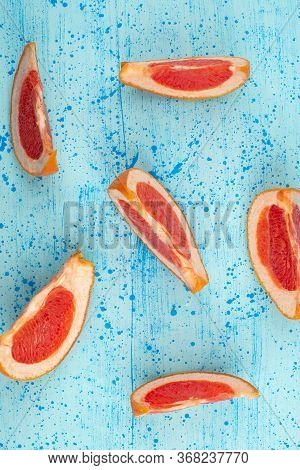A Top View Sliced Grapefruit Mellow Fresh Ripe On The Bright Blue Desk