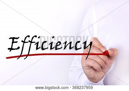A Person Writes Text, A Word, The Phrase Efficiency With Marker On A Light Background. Business Conc