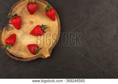 A Top View Red Strawberries Mellow Juicy Isolated On The Dark Floor
