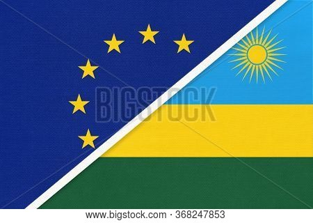 European Union Or Eu And Rwanda Or Ruanda National Flag From Textile. Symbol Of The Council Of Europ