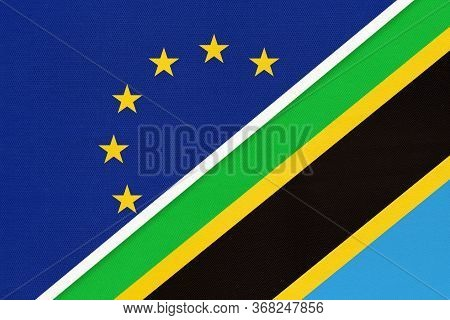 European Union Or Eu And Tanzania National Flag From Textile. Symbol Of The Council Of Europe Associ