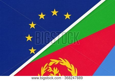 European Union Or Eu And State Of Eritrea National Flag From Textile. Symbol Of The Council Of Europ