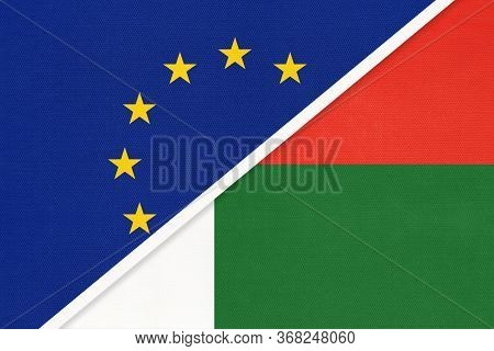 European Union Or Eu And Madagascar National Flag From Textile. Symbol Of The Council Of Europe Asso