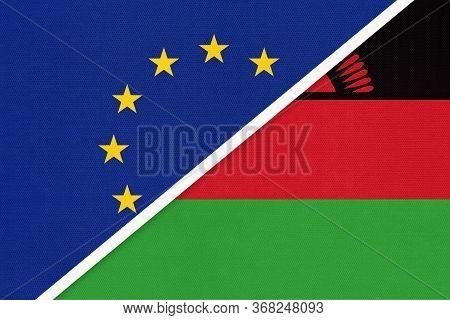 European Union Or Eu And Malawi Or Nyasaland National Flag From Textile. Symbol Of The Council Of Eu