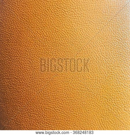 Texture Of Genuine Leather Close-up, Cowhide, Orange. For Natural, Artisan Backgrounds