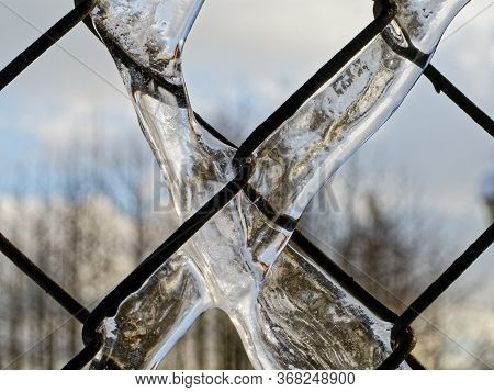 Ice Covered Chain Of Chain Link Fencing