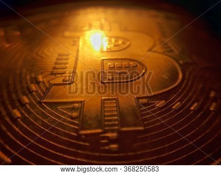 Detailed Macro Shot Of Golden Physical Bitcoin, Btc