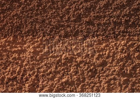Wall With Brown Plaster Texture Background. Coffee Color Backdrop. Bronze Ochre Orange Shades Surfac