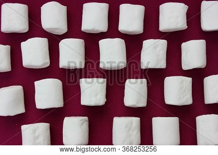 Marshmallows On A Pink Background. Fonso Sweets With Place For Text. Lot Of Whole White Sweet Fluffy