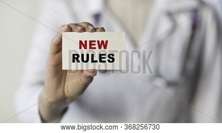 Text New Rules Written On Note Paper Putting In A Pocket By A Doctor. Medical Concept.