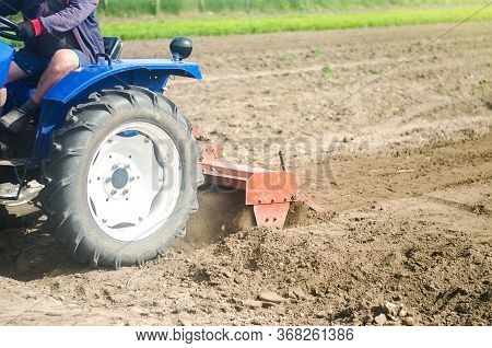 Tractor With Milling Machine Loosens, Grinds And Mixes Soil. Farming And Agriculture. Loosening The