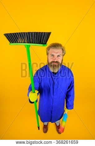 House Cleaning. Cleaning Time. Smiling Man In Uniform With Broom. Cleaning Equipment. Domestic Servi