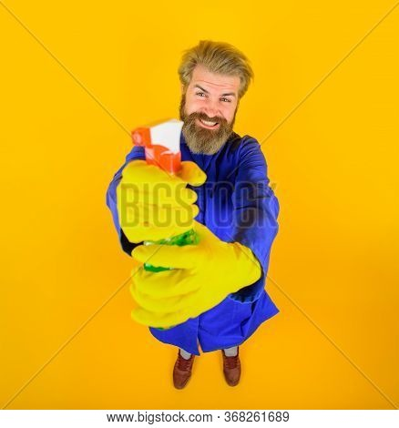 Cleaning Service. Cleaning Product. Bearded Man In Uniform With Cleaning Equipment. Bearded Man In G