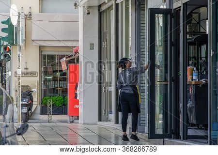 Thessaloniki, Greece - May 25 2020: Bars Open For The First Day For The Summer. Clerk With Protectiv