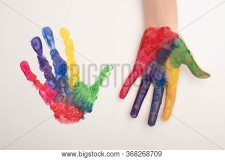 Cropped View Of Female Hand With Colorful Handprint On White For World Autism Awareness Day