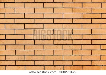 Smooth Yellow Brick Wall. Texture Of Yellow Brick. \\nthe Background Of The Wall Is Made Of Yellow B