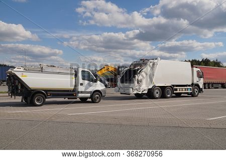 Garbage Trucks In The Foreground. Truck Stop. A Row Of Trucks During A Stopover, Travel Breaks.