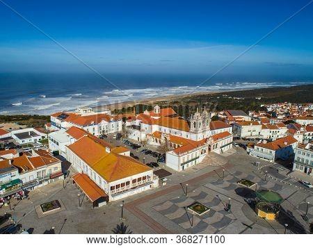 Aerial view of Church of Nossa Senhora da Nazare on the hilltop Nazare, Portugal