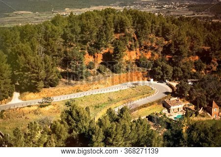 Picturesque Panoramic Road Between Ocher Hills Near Medieval Village Roussillon, One Of The Most Bea