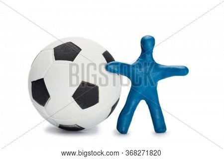 Plasticine small blue person soccer player with a ball isolated on white