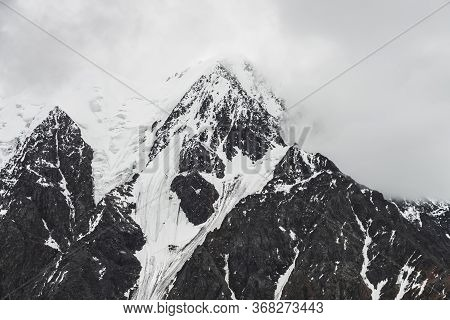 Atmospheric Minimalist Alpine Landscape With Massive Hanging Glacier On Snowy Mountain Peak. Big Bal